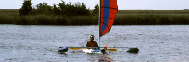 BSD sailing kayak with Batwing sail and Boss outriggers